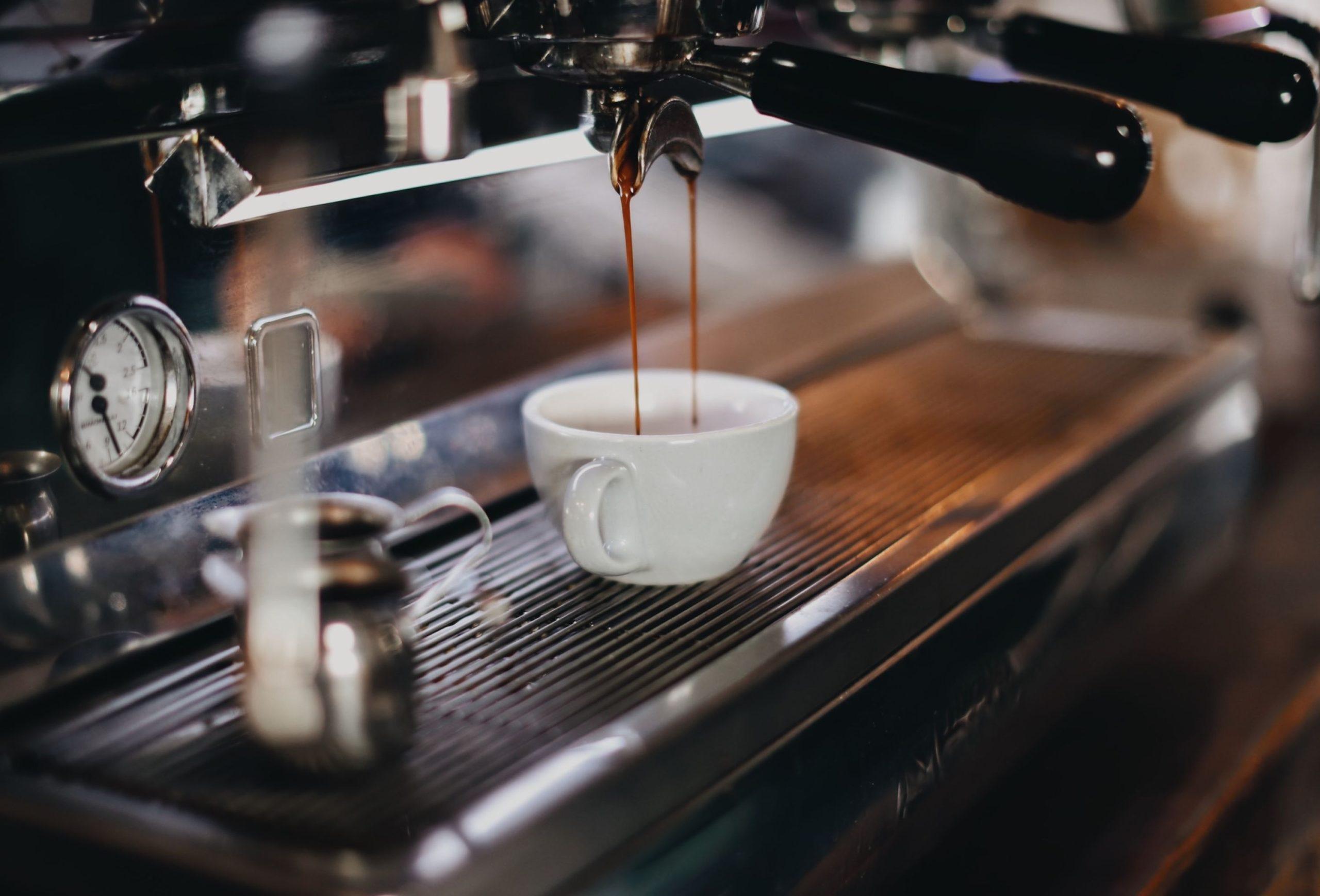 espresso pouring from machine into espresso mug